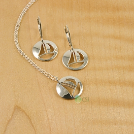 Shiny Sail Boat Dainty Pendant and Lever Earrings.jpg