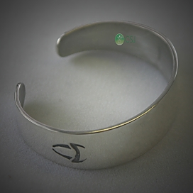 Custom Silver Cuff with Logo.jpg